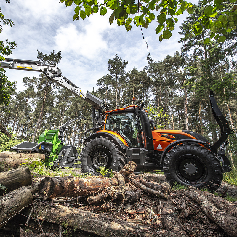 valtra t series in forest working candy orange colour